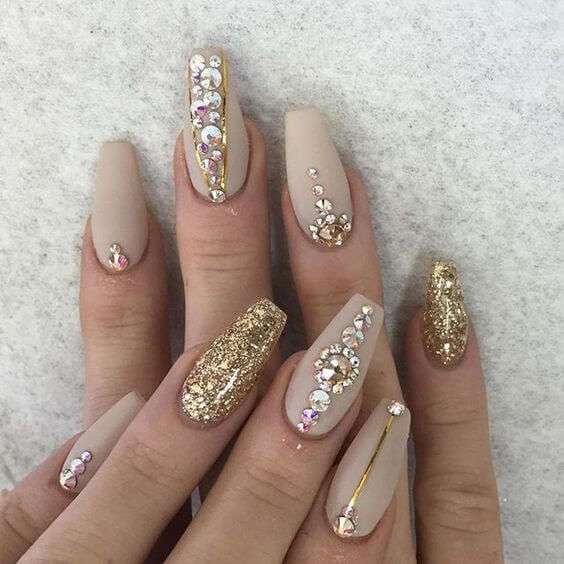 acrylic nail extensions with glitter and stones design
