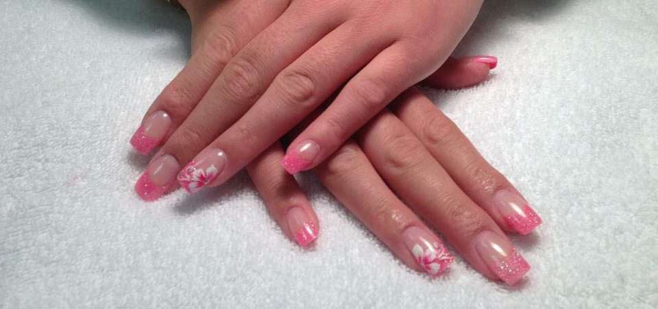 clear nail extensions with glitter tips and flower designs