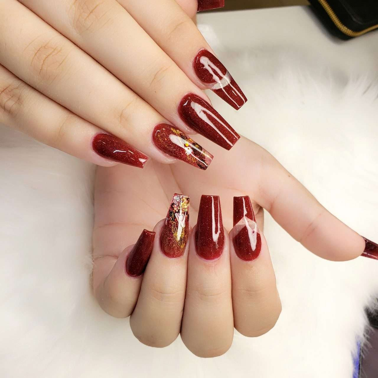 coffin shape nails with shellac on top and designs